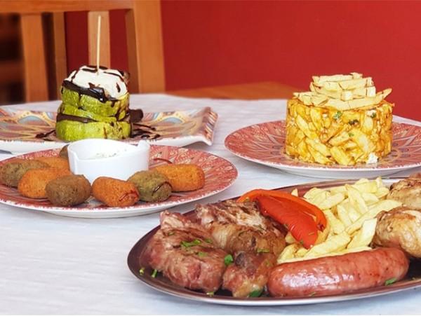 Menú con parrillada y auténtica carne de cochino negro, entrantes y bebidas para 2 personas
